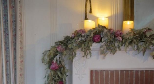 pink rose garland on mantel